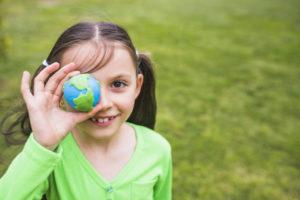 close up pretty girl holding clay globe hand 23 2148163972